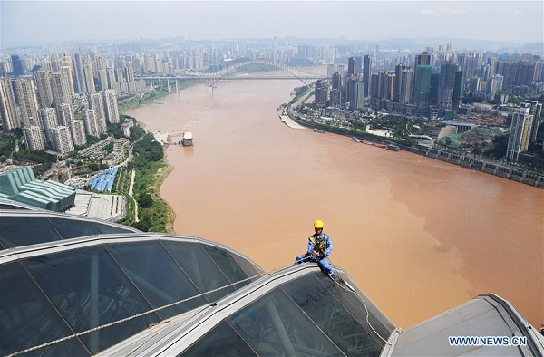 People work in heatwave in China's Chongqing